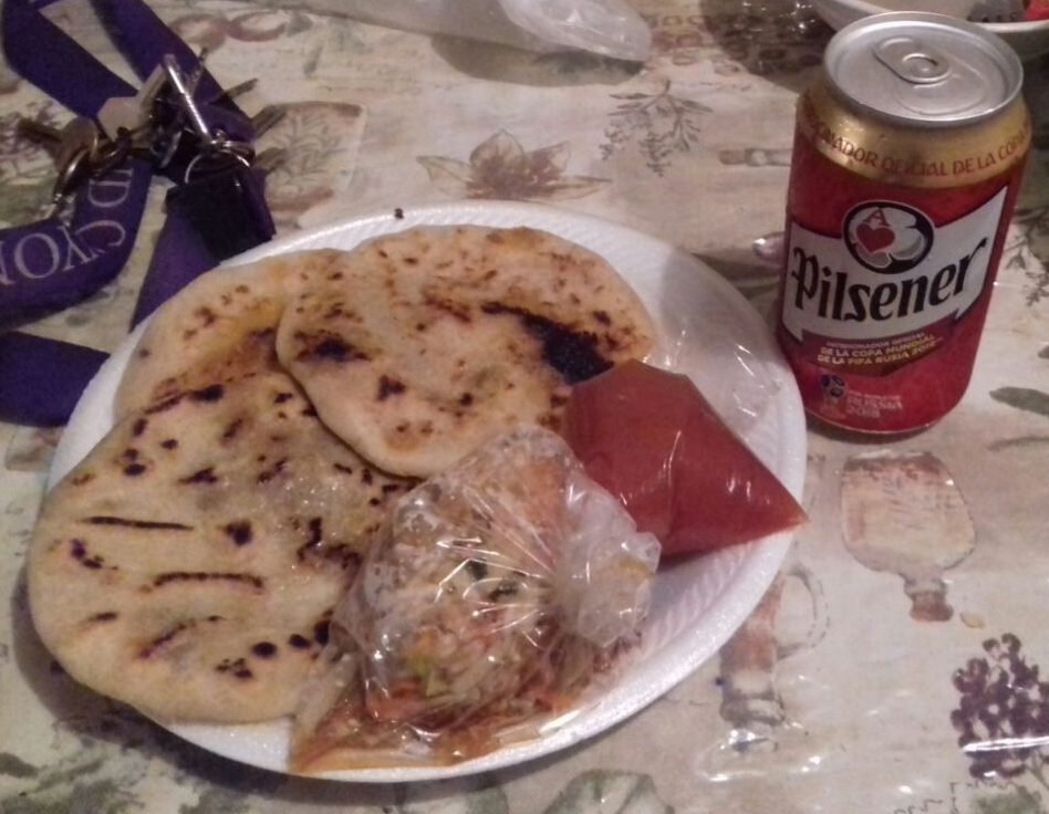 Red tomato sauce and pickled vegetables served with pupusas